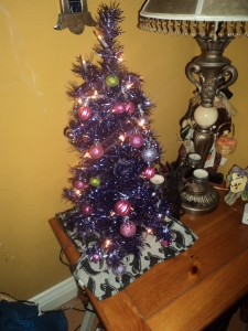 Purple tinsel trees on ghostly skirts...