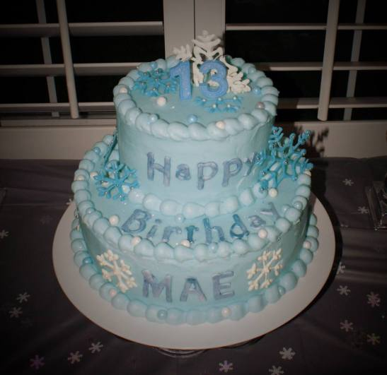 Frozen birthday cake with fondant snow flakes.