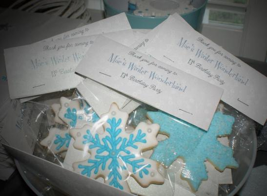 Frozen inspired cookies, expertly decorated sugar cookies in blue and white frosting, with a thank you for coming!
