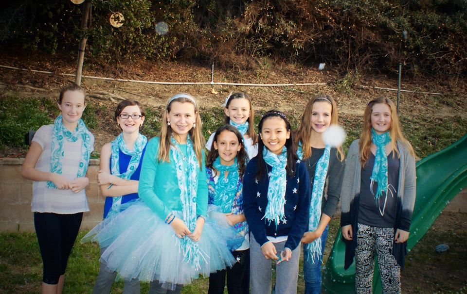 Mae and Friends after the snow... wearing adorable fleece scarves at this 13 year old's elegant chic Frozen Inspired party