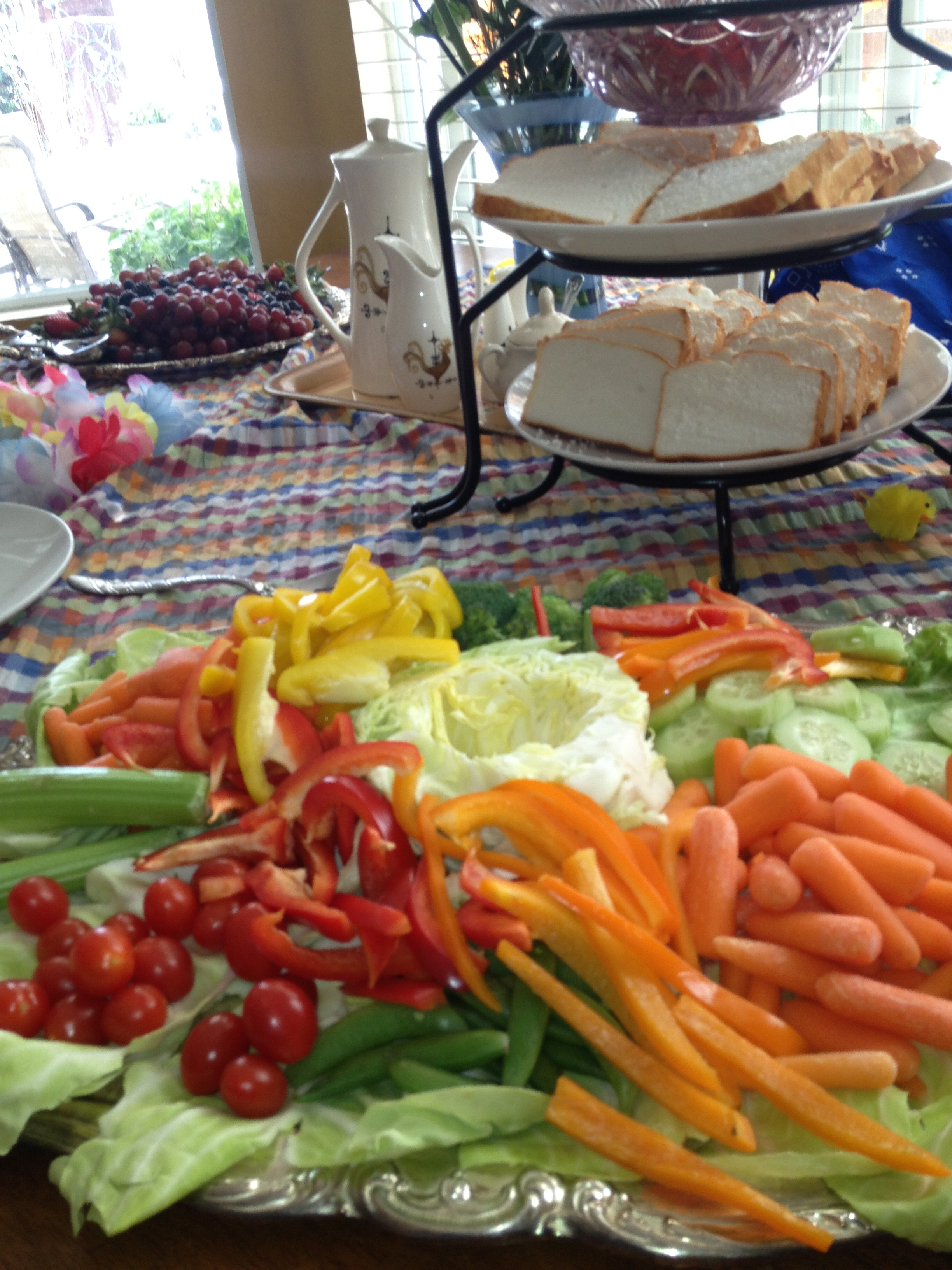 bountiful veggies on lettuce covered trays for the farm party
